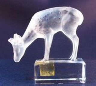 This is a beautiful Lalique French Crystal deer fawn figurine with a