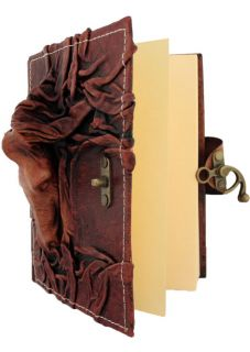 on A Brown Leather Bound Journal Notebook Diary Sketchbook