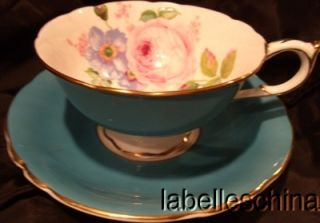 Paragon Teacup and Saucer HPT Roses Inside Aqua Outside and Gold Gilt