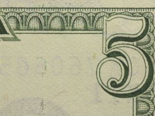 Close Up of Number on the Corner of a Five Dollar Bill Photographic