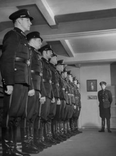 Long Line of Policemen Standing at Attention Premium Photographic Print by Mark Kauffman