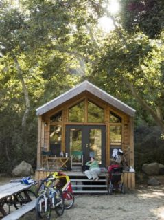 Woman Relaxes at el Capitan Canyon Cabin in the Sycamore Trees Photographic Print by Rich Reid