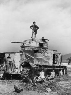 Italian Boy Standing on Top of Single Us Army Tank Remaining on the Edge of the Beach at Salerno Premium Photographic Print by Alfred Eisenstaedt