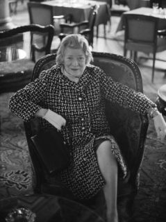 Writer Janet Flanner Sitting in Cafe Premium Photographic Print by Bill Ray