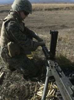 A Soldier Changes the Barrel of an M2 50 Caliber Machine Gun Photographic Print