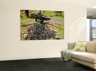 A .50 Caliber Browning Machine Gun with a Pile of Spent Cases and Links Wall Mural by Stocktrek Images