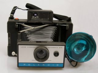 POLAROID 210 LAND CAMERA WITH 268 FLASH