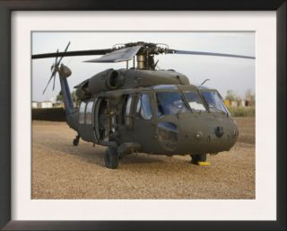 A UH 60L Black Hawk with Twin M240G Machine Guns Posters