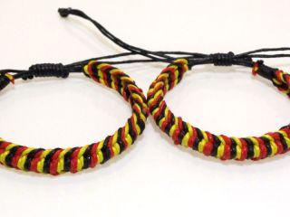 2x EM Armbänder schwarz rot gelb/gold Freundschaftsarmbänder Armband