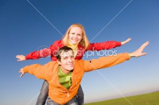 Happy smiling couple fly in sky  Stock Photo © Eduard Stelmakh