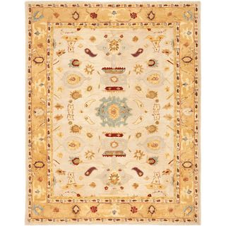 Handmade Tribal Ivory/ Gold Wool Rug (96 x 136)