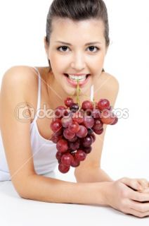Woman holding a bunch of grapes  Stock Photo © Vitaly Valua #1477701