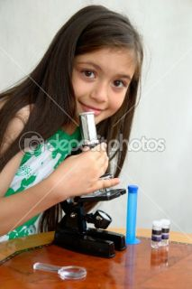 Little girl analyses with a microscope  Stock Photo © Orhan Çam